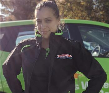 SERVPRO of Middletown shares picture of one of their female project managers standing in front of their SERVPRO vehicle.