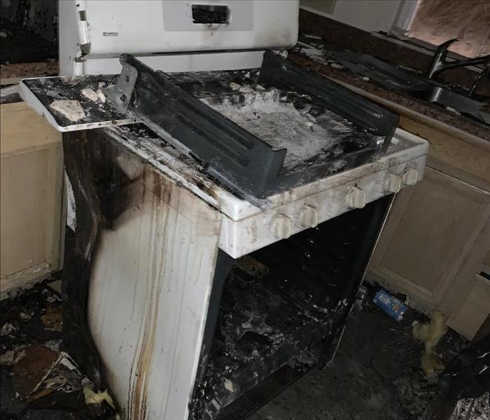 Soot covered stove and kitchen